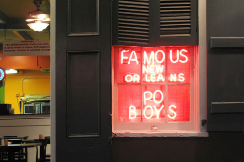 restraurant with red sign saying Famous New Orleans Po Boys