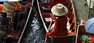 woman in hat in row boat