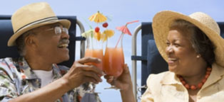 couple in lounge chairs toasting