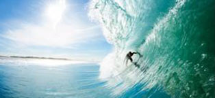 man surfing under big wave
