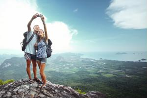 couple taking selfie on top of mountain